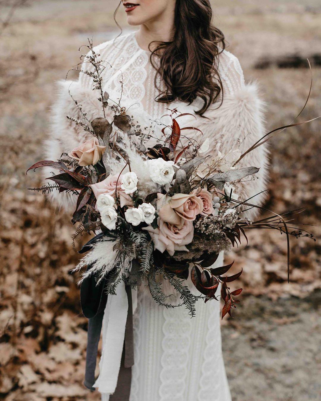 {love•ly} photo | @jessjolinphotography  design/planning | @nicolemowerevents . . #bride #bouquet #weddingday #fallwedding #cozyvibes #moody #romantic #thoselips #nhwedding #lotusfloraldesigns  #weddingflowers #weddingdesign #love #ido #forever